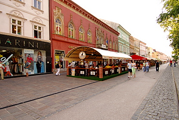 Shops lining a street with a tram line in the historic town of Kosice in eastern Slovakia.
