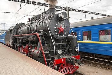 Old steam locomotive in the central station in Kiev, the Ukraine, Europe