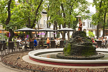 Fountain and restaurant tables in the Palais Royal Garden in Odessa, Ukraine, Europe