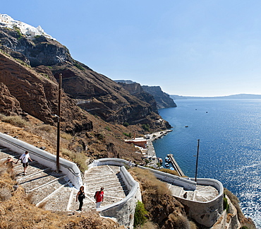 Tourists on the steps leading to the old port of Fira on the Greek island of Santorini, Cyclades, Greek Islands, Greece, Europe