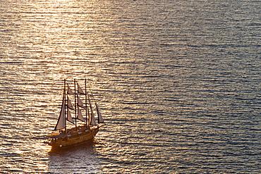 Sailing boat off the coast of Santorini, Cyclades, Greek Islands, Greece, Europe