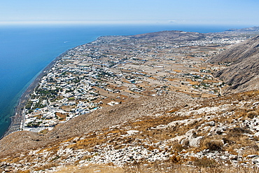 View from Messavouno mountain onto the beach and village of Perissa and the area of Perivolos on the Greek island of Santorini, Cyclades, Greek Islands, Greece, Europe