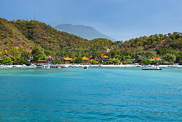 Padang Bai beach and the peak of Mount Agung on the island of Bali, Indonesia.