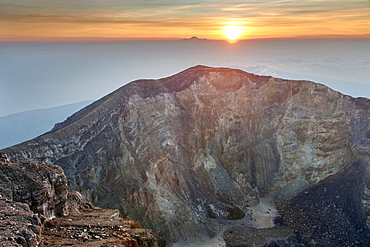 Sunrise seen from the summit of Gunung Agung (3142m), the highest volcano on the island of Bali, Indonesia.