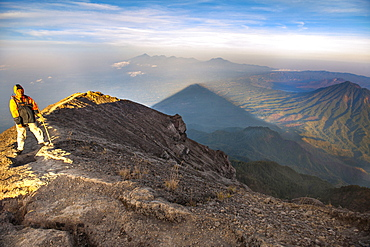 Balinese guide on the path leading to the summit of Gunung Agung (3142m), the highest volcano on the island of Bali, Indonesia.