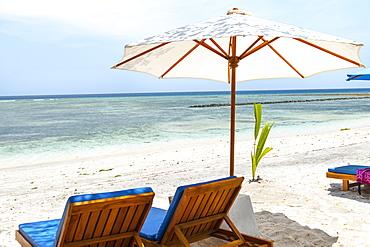 Beach loungers on Gili Air island, Indonesia.