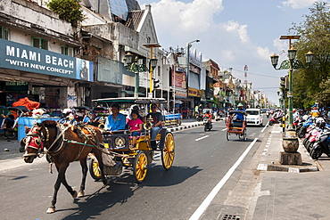 Horse drawn carriage on Jalan Malioboro, one of the main avenues in Yogyakarta, Java, Indonesia.
