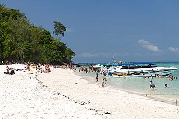 Tourists on Bamboo island (Ko Mai Phai) near Koh Phi Phi in the Andaman Sea on Thailand's west coast.