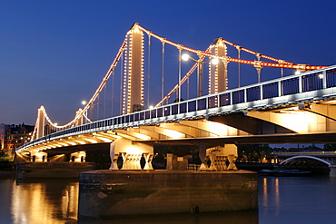 Dusk view of Chelsea Bridge which spans the Thames River in London.