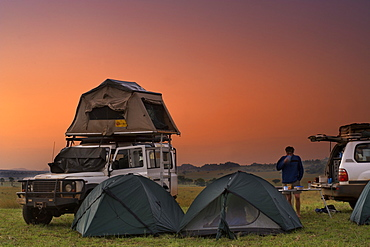 Land Rover Defender and tents at the campsite in Kidepo Valley National Park in northern Uganda.