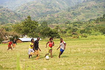 Ugandans playing football in western Uganda.