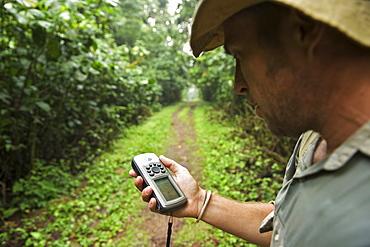Man with a GPS in the rainforests of Bwindi Impenetrable National Park in southern Uganda.