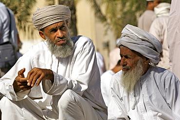 Omani men at the Friday market in Nizwa in Oman.