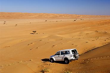 4WD in the dunes of Wahiba Sands (Ramlat al Wahaybah) in Oman.