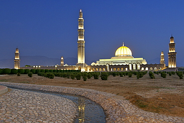Dusk view of the Sultan Qaboos Grand Mosque in Muscat, the capital of Oman.