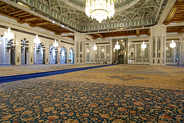 Interior of the prayer area of the Sultan Qaboos Grand Mosque in Muscat, Oman.