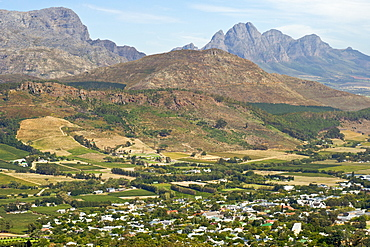 View across the vineyards and town of Franschhoek, Western Cape Province, South Africa.