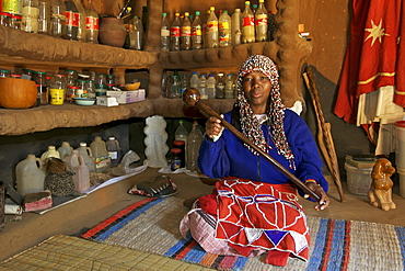 Aleta Thamae, a traditional sangoma posing in her consultation room in her house in the township of Refilwe near Cullinan in South Africa.
