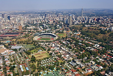 Aerial view of downtown Johannesburg and its eastern suburbs in South Africa. This view clearly shows the Johannesburg stadium and Ellis Park rugby and soccer grounds where some of the 2010 world cup soccer matches will be held.
