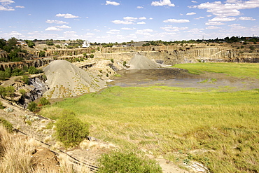 The De Beers diamond mine in Kimberley South Africa being filled with re-processed mine dump tailings from the De Beers combined treatment plant (CTP).