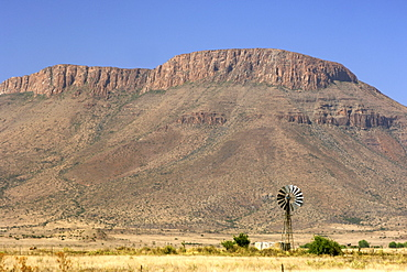Mountains and a windmill between Graaf Reinet and Middelburg in the Karoo region of South Africa's Eastern Cape Province.