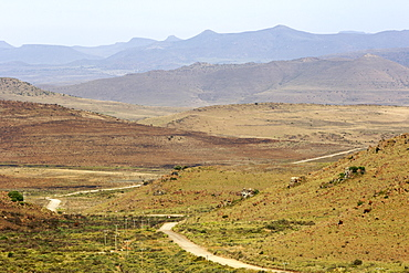 The gravel road in the Karoo leading to the town of Nieu Bethesda in South Africa.