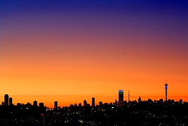 The Johannesburg skyline at dusk.