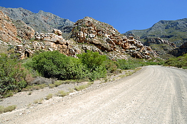 A gravel road leading through the Groot Swartberge mountain range between Calitzdorp and Laingsburg in South Africa's western Cape province.
