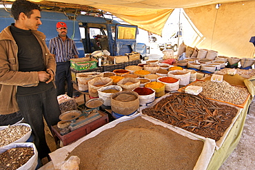 Spices for sale in a stall at an open air market near Ouarzazate in Morocco