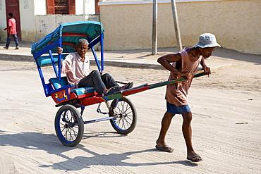 Rickshaw on the streets of Morondava in southwestern Madagascar, Madagascar, Africa