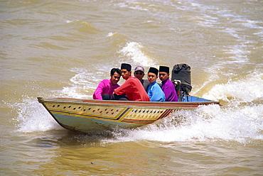 A group of men in a water taxi crossing the Brunei River in Bandar Seri Begawan, in Brunei Darussalam, Borneo, Southeast Asia, Asia