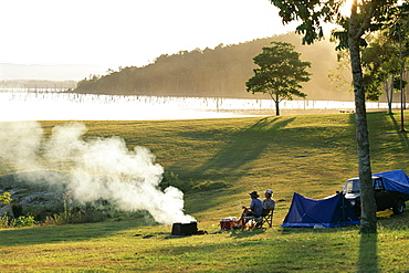 Campers by Lake Tinaroo, a recreation area in the Barron River hydro system on the Atherton Tableland, south west of Cairns, Queensland, Australia, Pacific