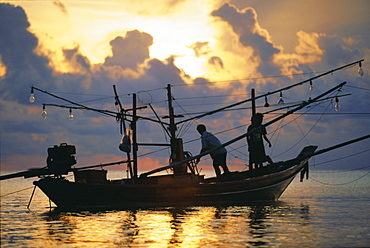 Fishing boat at sunrise at Haad Rin Beach, Koh Pha Ngan, Thailand