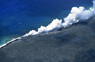 Steam cloud rising where lava from the Pu'u O'o cinder cone far inland enters sea on southeast Puna coast near Kaimu, Big Island, Hawaii, Hawaiian Islands, United States of America, Pacific, North America