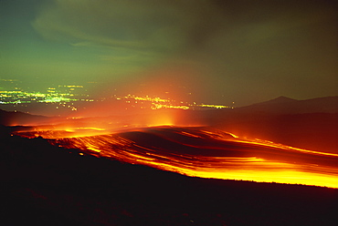 Lava flow from the Monti Calcarazzi fissure on the southern flank of Mount Etna in 2001, threatening the town of Nicolosi below, Sicily, Italy, Europe