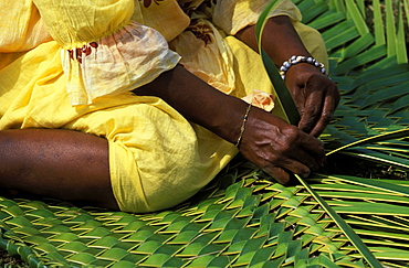 Woman weaving traditional pandanus mat at a Melanesian cultural festival, Efate Island, Port Vila, Vanuatu