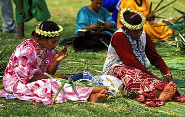 Women weaving traditional pandanus mat at a Melanesian cultural festival, Efate Island, Port Vila, Vanuatu