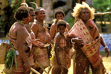Women from the island of Pentecost in a traditional dance at a Melanesian cultural festival. The fair haired one has a common genetic mutation, Efate Island, Port Vila, Vanuatu