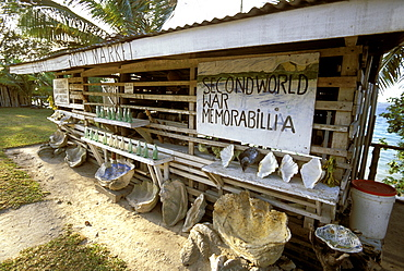 Stall selling WWII memorabilia (like old Coca-Cola bottles) and shells on the north coast. There was a large wartime American presence in Vanuatu, Efate Island, Vanuatu