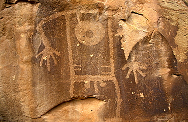 Petroglyph of male figure carved 1000 years ago by Fremont Native American people in the iron oxide 'desert varnish' on the sandstone of Cub Creek Valley in this fossil park, Dinosaur National Monument, Utah, United States of America (USA), North America