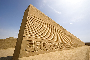 Restored wall with mythical bird motif in the Tschudi Complex, one of the ten 'ciudadelas' at Chan Chan,  pre-Columbian America's largest adobe city and capital of the Chimu Empire until its 14th century conquest by the Incas, Chan Chan, UNESCO World Heritage Site, Moche Valley, Trujillo, Peru, South America