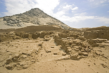 The peak of Cerro Blanco mountain and an unrestored section of this adobe brick temple pyramid of the Moche people (100BC-AD850) in the desert north, Huaca de la Luna, Trujillo, Peru, South America