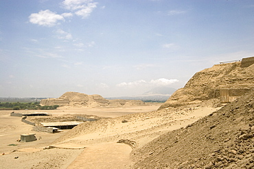 Looking from the Huaca de la Luna towards the Huaca del Sol, another adobe brick temple pyramid of the Moche people (100BC-AD850) and probably the largest adobe structure in pre-Columbian America, the Huacas, Trujillo, Peru, South America
