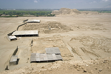 Looking from the Huaca de la Luna towards the Huaca del Sol - another adobe brick temple pyramid of the Moche people (100BC-AD850) and probably the largest adobe structure in pre-Columbian America, Huaca del Sol, Trujillo, Peru, South America