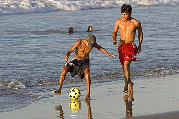 Football on the beach at this popular surfing resort in the far north near the Ecuadorean border, Mancora, Peru, South America