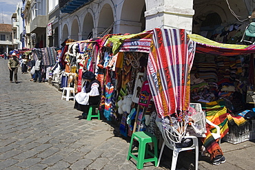 Colourful clothing and textiles for tourists in the market on Plaza San Francisco, Cuenca, Azuay Province, Southern Highlands, Ecuador, South America