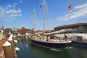 The 80 foot excursion schooner Aquidneck returning to Bowen's Wharf, established in 1760 and now a busy waterfront retail and tourist centre, Newport, Rhode Island, New England, United States of America, North America