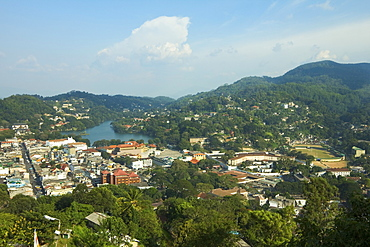View of the lake, Queens Hotel and Kandy City Centre complex on the left, with Bogambara Prison and Stadium on the right, Kandy, Sri Lanka, Asia
