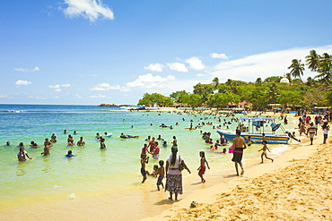 Sri Lankans swimming at the west end of this popular resort and beach, wrecked by the 2004 tsunami, Unawatuna, Galle, Sri Lanka, Asia