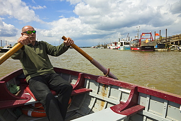 Man rowing the ferry to Walberswick over the River Blyth, a service dating back to the Middle Ages, Southwold, Suffolk, England, United Kingdom, Europe